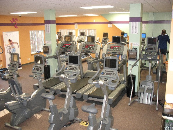anytime fitness running man. Running on a treadmill gives