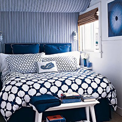 Need a basement transformation miracle for Blue patterned wallpaper bedroom