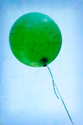 Avidan's eyes lit up as the man handed him the bright, green balloon, . (dsc copy)