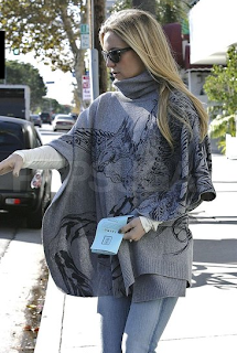Kate Hudson wearing Horiqushi the Third Knitted poncho with Phoenix print.