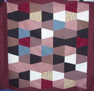 The blocks for this Tumbler quilt were cut on my 'Go' fabric cutter.