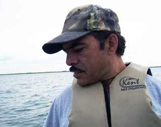 Mr. B steers the boat toward shore.