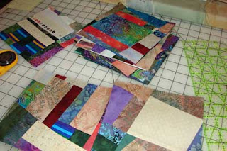I've started a collection of 6 1/2 inch crumb blocks for use in a quilt.