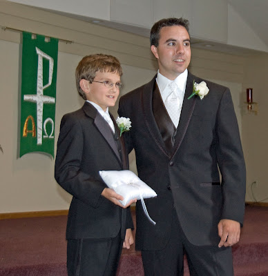 'One ring to bind them' - the ringbearer and groom.