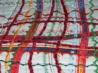 A closer view of the couching with yarn and ribbons for texture on a quilt.