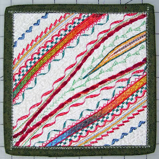 Here's another example of couching yarns and ribbons on an art quilt. This quiltlet is small.