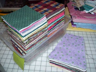 Got some big piles of five inch quilt squares already pre-cut and ready to sew.