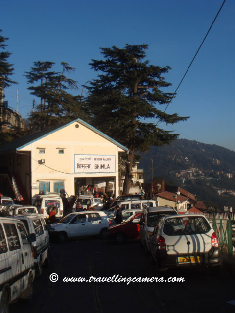 Travelling Camera @ Shimla Railway Station, Himachal Pradesh (Waiting for Himalyan Queen for back journey to Kalka): POSTED BY VJ SHARMA AT www.travellingcamera.com : Shimla Railway Station is under the administrative control of Northern Railways. It is located about 3.25 kilometers from Chotta Shimla. It has a narrow gauge railway line linked to Kalka (92 kilometers) on which the toy trains run. The journey on the toy train offers amazing experience to the travellers. Shivalik Express, Shimla Mail and Kalka Shimla Rail Motor Car (special train) pass through this station. Computerized reservation facility is provided...Himalyan Queen Waiting @ Shimla Railway Station...Don't miss the Doordarshan Tower on hill-top in this Photograph...A view of other side of Shimla.. Probably Chhota Shimla...A few minutes walk from the station is Shimla Bus Station. Just 2.5 kilometers from the railway-station is the Mall Road which is main attraction among Tourists in Shimla. The nearest airport is Shimla Airport at Jubbalhatti which is around 25 kilometers from Railway Station...A View of deep valley from Himalyan Queen @ Shimla Railway Station.Its time to depart from Shimal and forget this freshness...Main Entry to Shimla Railway Station...The route offers a panoramic views of the amazing Himalayas from the Sivalik foot hills at Kalka to several important points such as Dharampur, Solan, Kandaghat, Taradevi, Barog, Salogra, Summerhill and Shimla at an altitude of 2100 meters...