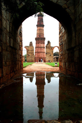 Qutub Minar reflection in water. This is very rare image which includes actual Qutub Minar as well as its reflection. I feel very lucky to get this water which was on  ground due to water overflow