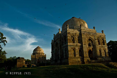Posted by Ripple (VJ) : Sheesh Gumbad in the middle of Lodhi Garden : ripple, Vijay Kumar Sharma, ripple4photography, Frozen Moments, photographs, Photography, ripple (VJ), VJ, Ripple (VJ) Photography, Capture Present for Future, Freeze Present for Future, ripple (VJ) Photographs , VJ Photographs, Ripple (VJ) Photography : As there is little architecture from these two periods remaining in India, Lodi Gardens is an important place of preservation. The tomb of Mohammed Shah is visible from the road, and is the earliest structure in the gardens. The architecture is characterised by the octagonal chamber, with stone chhajjas on the roof and guldastas on the corners.Another tomb within the gardens is that of Sikander Lodi, which is similar to Mohammed Shah's tomb, though without the chhatris, it was built by his son Ibrahim Lodi in 1517, the last of Sultan of Delhi from Lodi dynasty, as he was defeated by Babur, First battle of Panipat in 1526, this laying the foundation of the Mughal Empire. His tomb is often mistaken to be the Sheesh Gumbad, and is actually situated in near the tehsil office in Panipat, close to the Dargah of Sufi saint Bu Ali Shah Qalandar. It is a simple rectangular structure on a high platform approached by a flight of steps. The tomb was renovated by the British, and an inscription mentioning Ibrahim Lodi's defeat at the hands of Babur and the renovation was included in 1866
