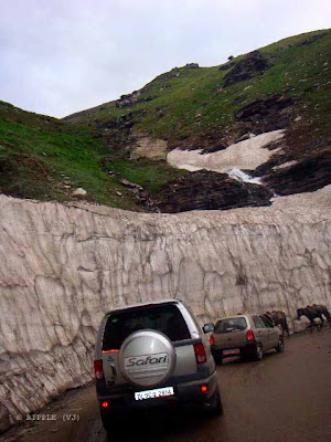 Busy route of Rohtang Pass, which leads to heavy Traffic Jams in Summers: The road through the Kullu Valley, past Manali and over the Rohtang Pass to Keylong, and Lahul and on to Ladakh, has become very busy during the summer months as an alternate a military route following the Kargil Conflict in 1999 in addition to tensions in Kashmir. Traffic jams are common as military vehicles, trucks, and goods carriers try to navigate the tight roads and rough terrain, compounded by, snow and ice at certain points and the large number of tourists vehicles. There are a lot of dhabas or Indian-style food shacks and eateries along the way.:Posted by Ripple (VJ) on PHOTO JOURNEY @ www.travellingcamera.com : ripple, Vijay Kumar Sharma, ripple4photography, Frozen Moments, photographs, Photography, ripple (VJ), VJ, Ripple (VJ) Photography, Capture Present for Future, Freeze Present for Future, ripple (VJ) Photographs , VJ Photographs, Ripple (VJ) Photography : Finally we reached Rohtang Pass... We were lucky because last day 80% tourists had to get back from Rahla Falls due to a similar Traffic Jam...