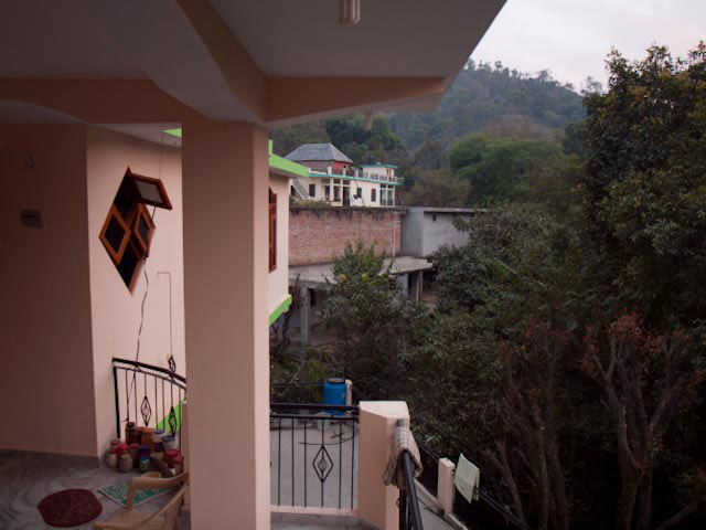 Missing my Home in these busy days : Posted by VJ SHARMA @ www.travellingcamera.com : I don't know why but today I missing my family.. While looking through my family photographs I found some of the photographs of our new house in Mandi, Himachal Pradesh... Here are few pics :-)A view of upper storey of our sweet house...Tried to cover lower part of our house.. btw, all these photographs are clicked by my Dad...Another shot from our courtyard...Sunset view from one of the balconies in this house... Same view with brighter colors...Time to switch on all the lights ...Sunset light still drawing some forms on walls inside...Lower part of the house...Some open area called as Varandah...Again a shot of balcony covering lower part....A view to other houses around....