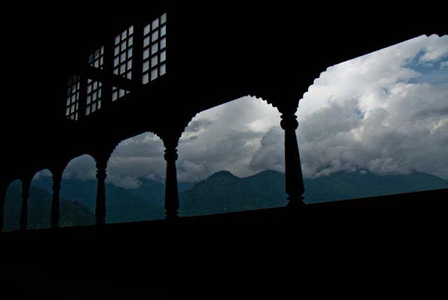 Naggar Castle is my favorite place to stay in Kullu-Manali Region of Himachal Pradesh... Last year when I visited Manali, we spent some very good time here at Nggar Castle Hotel of HPTDC and here I am going to share some wonderful views of Kullu Valley and adjacent hills...This hotel has some extended balconies in all the directions facing Kullu Valley... There are some unique galleries around the hotel which are made up of wood only... Iron sheets are used at some places on the roof-top because of heavy snowfall...Here comes the first view of Kullu Valley having lot of apple orchids, Beas River, clouds and green areas... This balcony was just outside the rooms in Naggar Castle...Hotel Castle is an unique medieval stone and wood mansion once the home to the Raja of Kullu and now an HPTDC Heritage hotel...  On moving eyes up to 60 degree, there are amazing views of hills covered with snow or clouds...Another view to opposite side of the valley from extended balcony of Naggar Castle restaurant....Naggar Castle overlooks the Kullu Valley and apart from the spectacular view & superb location this has a flavor of authentic western Himalayan architecture....King's Castle was converted into a rest house a hundred year back and in 1978 this ancient building was handed over to HPTDC to run as a heritage hotel...Here is a view of Naggar town from Castle premises....A view of extended balcony of Naggar Castle and cloudy hills in he background...Here a gallery houses the paintings of the Russian artist Nicholas Roerich...Naggar Village @ Kullu, Himachal Pradesh, INDIARooms at Naggar Castle are airy, spacious, well furnished with Parking within premises.... There is an Art Museum in ground floor of the Hotel... Here is my friend Nitin, who kept clicking photographs of this amazing place throughout our stay at Naggar Castle...Here is another view of Naggar from Hotel Resurant @ Naggar Castle... Hotel has Restaurant serving Indian, Continental, Chinese and Himachali cuisines....A photograph of open area inside Hotel premises which is bonfire or evening snacks... If you are wondering how this photograph is clicked because there is deep valley next to the Hotel ; its clicked from extended balcony of the rooms available for stay...Same view again...Kullu Valley which is also known as the