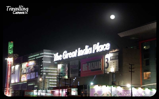 The Great India Place is a shopping mall in Noida, India. The Great INDIA Place is located in Sector 38-A, Noida... Here are few clicks on the mall which are clicked from moving car...The mall is itself part of the larger Entertainment City amusement park (Worlds of Wonder)...The mall houses a variety of retail outlets, including Shopper's Stop, Globus, Pantaloons, Big Bazaar, Home Town, Lifestyle and Lifestyle Home, along with international brands like Adidas, Nike, Guess, Marks & Spencer...Food and Entertainment zone on the top floor with a 6-screen BIG Cinemas multiplex having a total seating capacity of 1220 seats...A large chunk of the mall's total area is covered by Future Group ventures, including Home Town, Big Bazaar and Pantaloon....Great Inida Mall was developed by International Recreation Parks with a joint venture organization by Unitech Limted and International Amusement Limted... Unitech is engaged in the construction of residential and commercial complexes, running of luxury hotels, infrastructure project and education. Unitech is recognized as a leading player in property development and real estate in India... On the other hand, International Amusement became the pioneer in Amusement Park Industry in India by setting up India's first Amusement Park