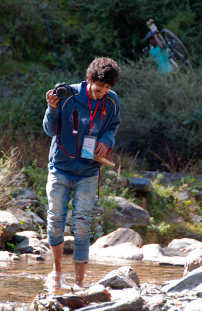 Few More Photographs of Second Day of MT Himachal 2010 - Post Hiking Stretch : Posted by VJ SHARMA on www.travellingcamera.com : Its been more than a week that I am posting MTB Himachal 2010 photographs here and hope viewers are enjoying this journey and can imagine the fun, passion, energy of this whole event. Here I am going to share few more photographs of second day and we have just completed hiking and biking session...Jimsee in Action...She was always carrying her tripod to capture all possible shots in available time...Say Cheeze... while waiting for more rider to come, I had few more participants, who were intereted in their photographs... Ankit, while crossing the river after taking some shots from other side of the river... He is the winner of MTB Himachal 2010 PHOTOQUEST and this is the place he shot the winning photograph...A Himachali Lady in deep thoughts...A quick click while climbing up the hill through Matdhar Village...Natural Beauty on the way.. Flower and a Butterfly...Innocent child standing on one side of the road to watch the show... He found us disturbing elements on the road and wanted us to move ahead as quickly as possible... Some part of this whole stretch was amazing and we had to time to stop and click.... Evening light was amazing but it was not possible to capture it well from moving car :( ... Here are few hills near Narkanda and we were moving towards Tani Jubbar Lake.. Our final destination for second day was a huge ground near Tani Jubbar Lake... But most importantly, we got charging points there :)PHOTOQUEST Champion capturing this beauty near Narkanda...I tried to copy him :) but somehow was not able to capture it well...A view of village spread over various parts of a hill...Come on Chintu !!! This is what we said before clicking his potograph.. For bikers, it was difficult and steep climb... and the shadows of the cycle is indicating evening time of second day and a hope of completion of this day... Second day was really tiring and everyone wanted to take rest...Simply wanted to capture colors of himalayas which can't be seen anywhere else... I love this bright blue ...One of the rider draggin his cycle because of some techincal fault which needs significant time to repair... During these situations, riders were not allowed to carry their cycles in other vehicles... So everyone had to reach the destination either by riding the bike or dragging it, if required...