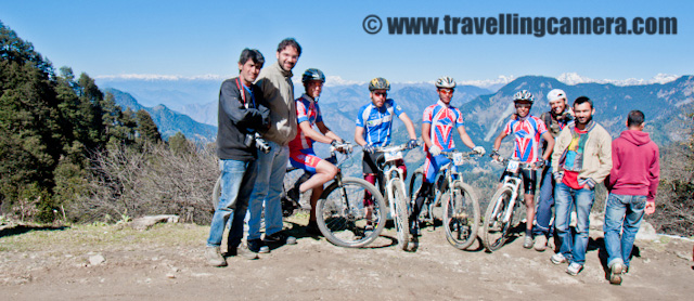 MTB fun on Sixth day at Jalori Pass covered with Snow (Mountain Terrain Biking in Himachal Pradesh) : Posted by VJ SHARMA on www.travellingcamera.com :Jalori Pass was an exciting destination to hit during our MTB Journey which started from Shimla during last year... Jalori Pass is at 11000 feet and its considered as the nearest mountain pass from Delhi... Its  approximately 600 km away from Delhi... Jalori Pass is a popular destination on adventure tourist's map... Here are few photographs of Jalori Pass clicked during 6th day of MTB Himachal 2010...It was sixth day of MTB Himachal when we had to reach Jalori Pass during the noon ... Everyone was excited about the fact that Jalori Pass has got fresh snowfall and they are going to have fun there.. So after reaching the place, riders parked their bikes and moved towards the hills covered with snow.. Here is a photograph of bike parked with snow on the background hills...Here are two champions of PHOTOQUEST who enjoyed the most during our break of 1.5 Hrs at Jalori Pass... A small market is there on the entry of Jalori Pass and crossing through the hills behind temple, we found lot of snow on neighboring hills.... Ankit and Sumit had great fun their by experimenting various tricks in snow...Full on masti at Jalori Pass.. Here Ankit was trying to make a hole in the snow by jumping on top of it... He wanted to see the actual depth of this snow-store...I had very few photographs during MTB Himachal but at Jalori I wanted to have one :) ... A proof that we saw snow in Jalori Pass in October !!! Yo !!!There is a temple in the middle of Jalori Market and this photograph is showinf snow on hills behind Jalori Temple.. Snow level was increasing as we started moving on the road which connects Jalori Pass with Bangar Region...There were few PR people with MTB troop and they continuously connected some selected riders with various news agencies... Here one of the riders at Jalori Pass talking to some journalist over phone... He i