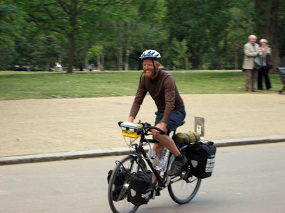 James Bowthorpe arrives back in Hyde Park, London, having broken the world record for cycling around the world.