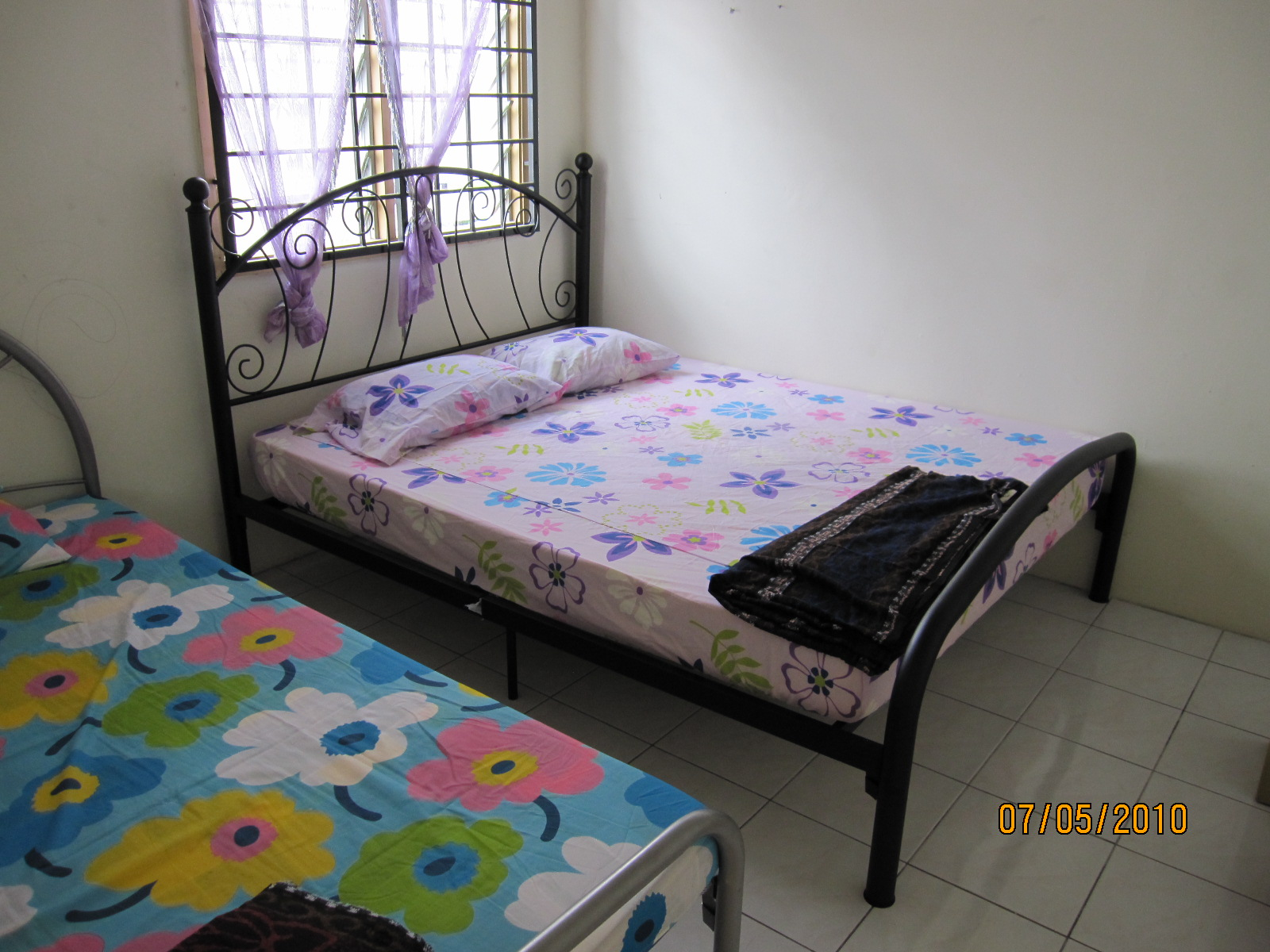 furnished room with Queen size bed single bed and air conditioning  #2B4B61