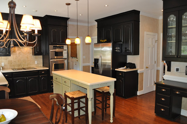 The collected interior black painted kitchen cabinets for Area above kitchen cabinets called