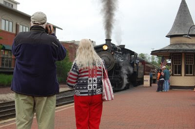 Tourists taking photo of a train, New Hope Pennsylvania.