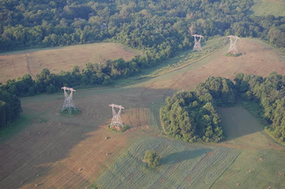 High tension towers seen from above.