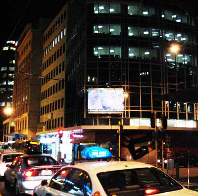 Illuminated animated sign, cnr Customhouse Quay & Willeston St