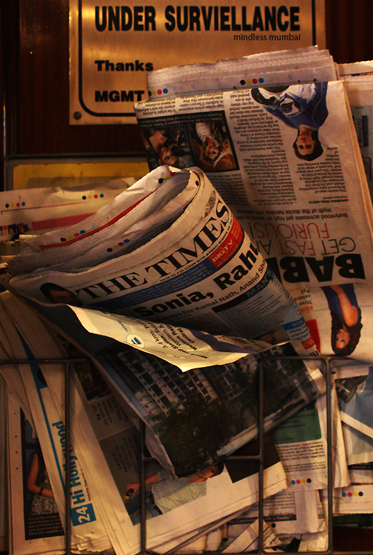 stack of newspapers in mumbai by kunal bhatia