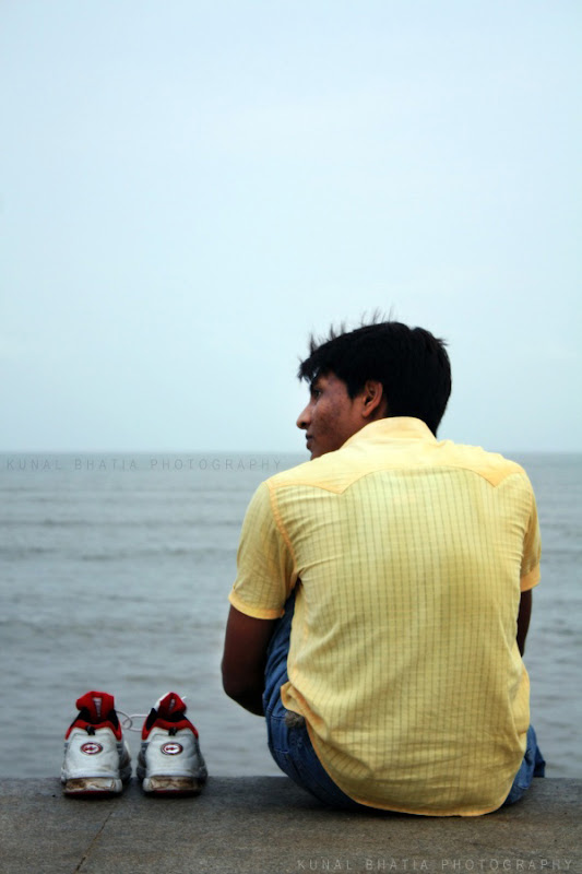 sitting by the sea and reflecting thinking at marine drive in mumbai by kunal bhatia