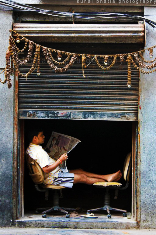 mumbai shop shutter down sunday lazy newspaper read by kunal bhatia
