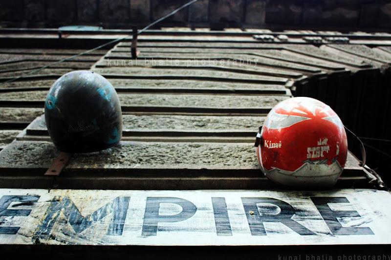 biker helmets hanging on a wall in mumbai by kunal bhatia