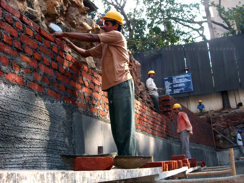 construction workers laying bricks at site in mumbai by kunal bhatia photo blog