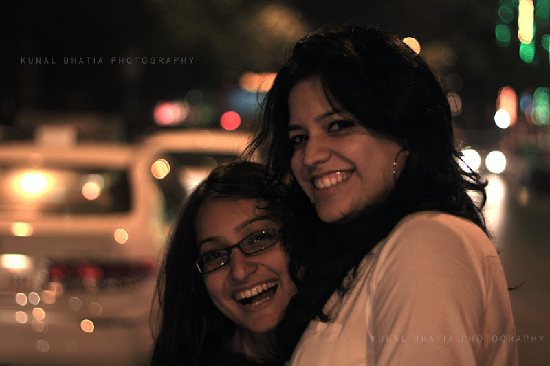 friends smiling night portrait street lights car lights in mumbai by kunal bhatia