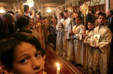 palestinian greek orthodox worshippers gather during the christmas mass at saint perforius church in gaza city sunday jan 7 2007 - When Is Greek Orthodox Christmas