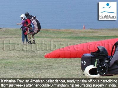 Katharine Frey taking off on a paragliding flight just weeks after her Birmingham hip resurfacing surgery in India