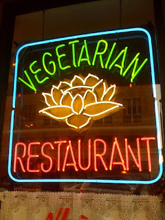Neon sign reading Vegetarian Restaurant at Golden Lotus, Oakland, CA, photograph by A.E. Graves
