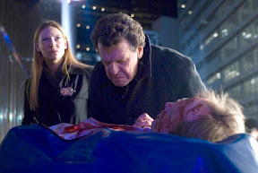 FRINGE: Walter (John Noble, R) and Olivia (Anna Torv, L) investigate a death at Massive Dynamic headquarters in the FRINGE episode The Dreamscape