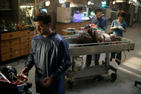 FRINGE: Peter (Joshua Jackson, L) works with Walter (John Noble, C) and Astrid (Jasika Nicole, R) to examine evidence in the FRINGE episode The Transformation