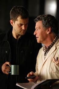 FRINGE: Walter (John Noble, R) and Peter (Joshua Jackson, L) discuss research footage in the FRINGE Season Two premiere episode 'A New Day in the Old Town' airing Thursday, September 17 (9:00-10:00 PM ET/PT) on FOX. ©2009 Fox Broadcasting Co. CR: Liane Hentscher/FOX