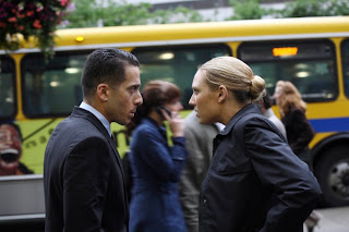 FRINGE: Olivia (Anna Torv, R) and Charlie (Kirk Acevedo, R) track a dangerous threat in the FRINGE episode 'Momentum Deferred' airing Thursday, Oct. 8 (9:00-10:00 PM ET/PT) on FOX. ©2009 Fox Broadcasting Co. CR: Liane Hentscher/FOX