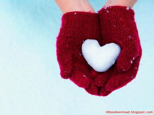 red gloves in the snow heart