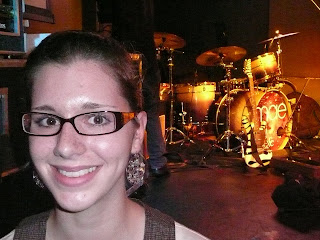 Me sitting on the stage with Jacob Marshall (of Mae)'s Singularity drumset in the background.