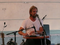 Switchfoot singer / guitarist Jon Foreman plays some kind of harp in the Nashville tent at the Revelation Generation festival, 2009.