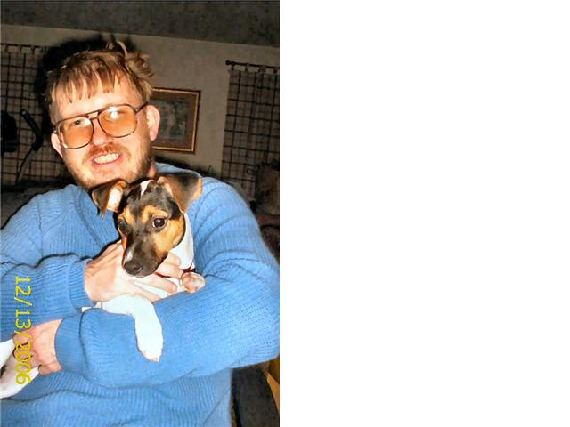 Precious and me when she was a puppy at Christmas 2006