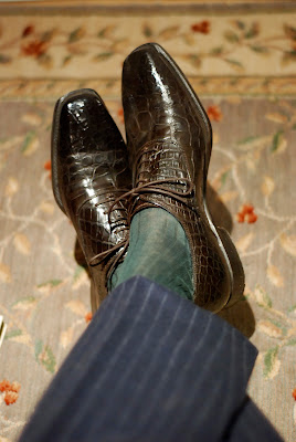 Green socks with a blue suit