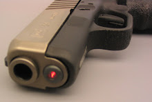 The Lasermax pulsating laser sighting unit simply replaces the Glock's guide rod-spring assembly.