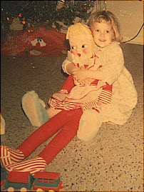 Daughter holding one of her first dolls