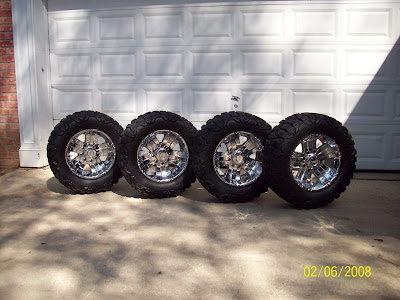 Tires on Racing Rims Wrapped With 33 Inch Nitto Mud Grappler Tires Tires