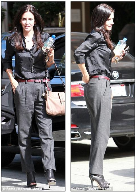 Telling: Courteney Cox arrives at an LA hotel today with her wedding ring
