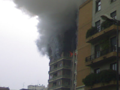 building on fire in Milan
