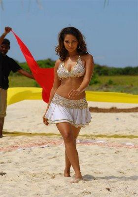 Kim Sharma at beach cleavage